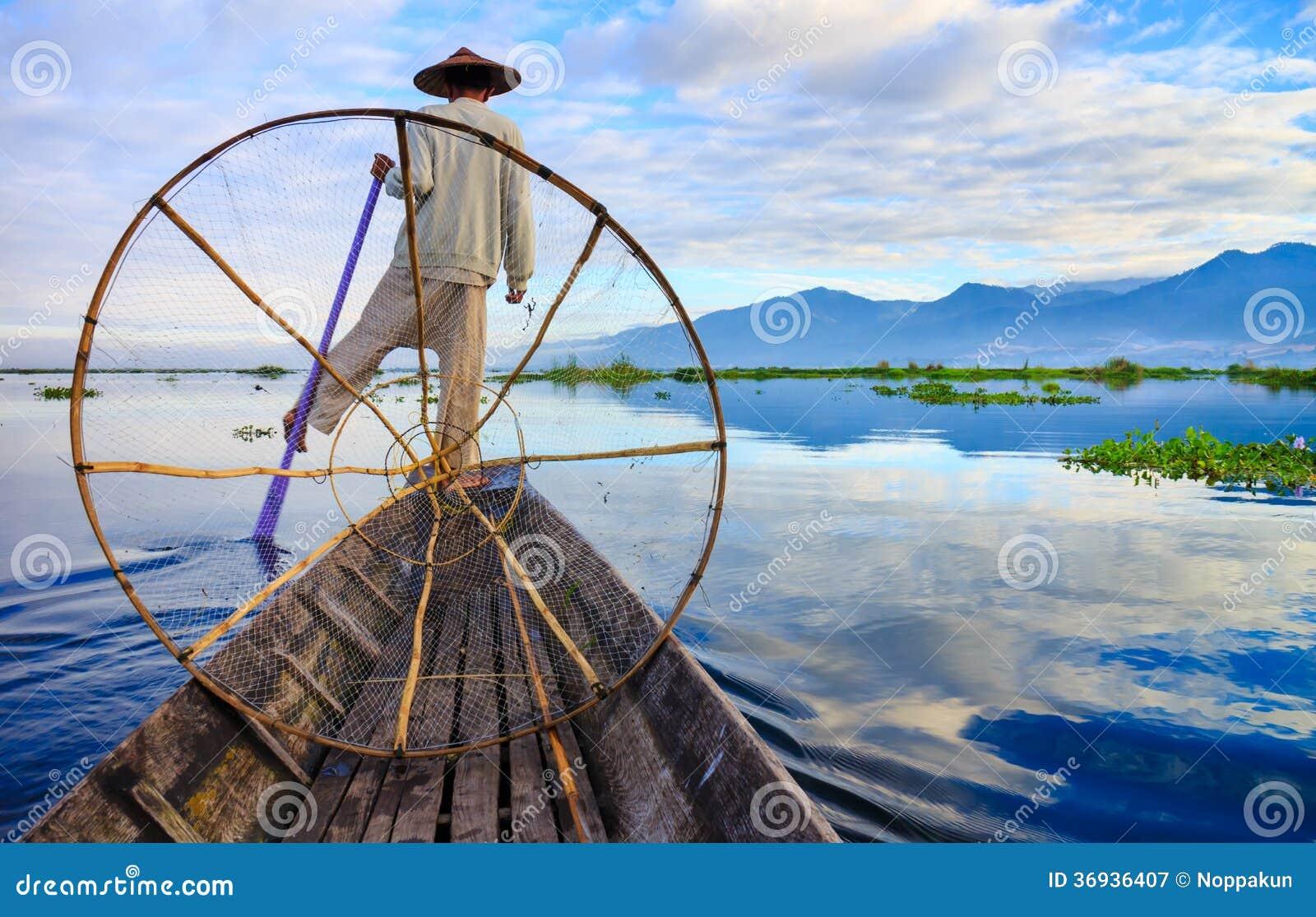 Fishermen in Inle Lake at sunrise, Shan State, Myanmar