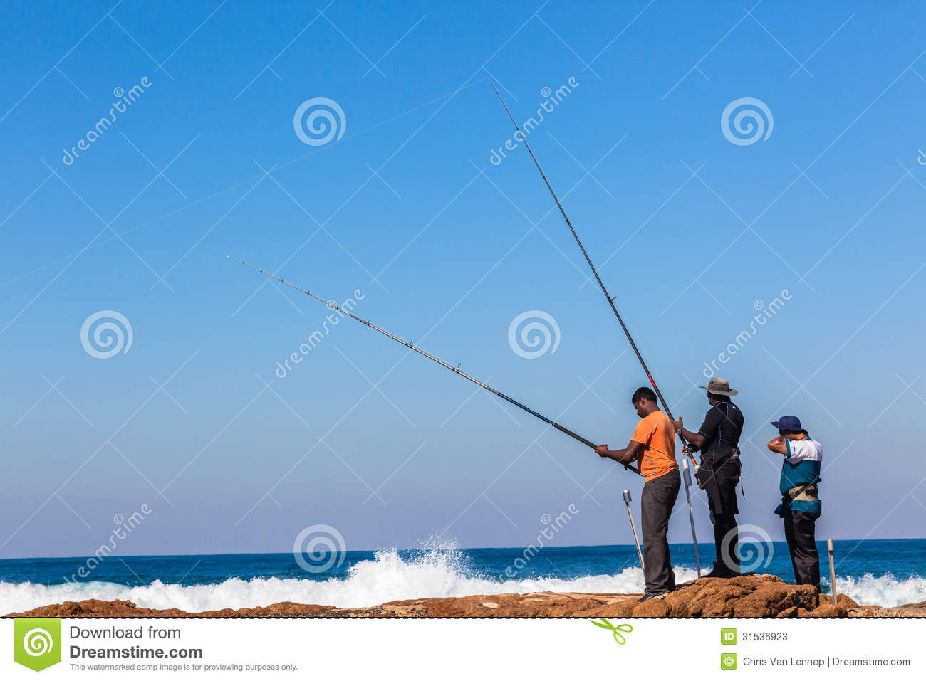 Fishermen rods rocks blue sea editorial stock photo for Into the blue fishing