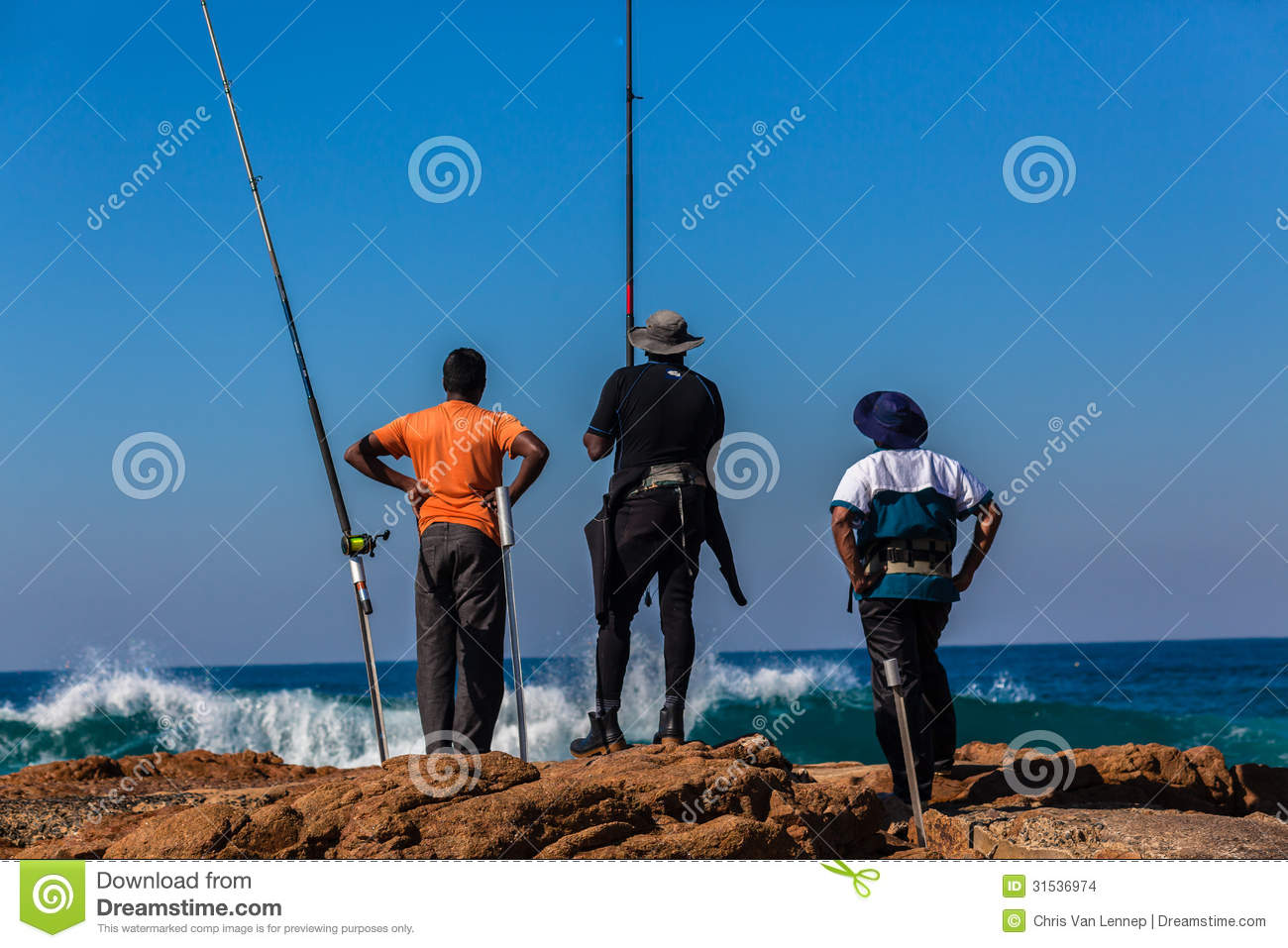 Fishermen rods rocks blue sea editorial stock image for Into the blue fishing