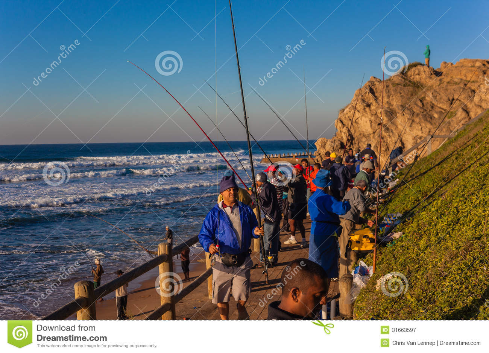 Fishermen season sunrise sea editorial photography image for Fishing high tide