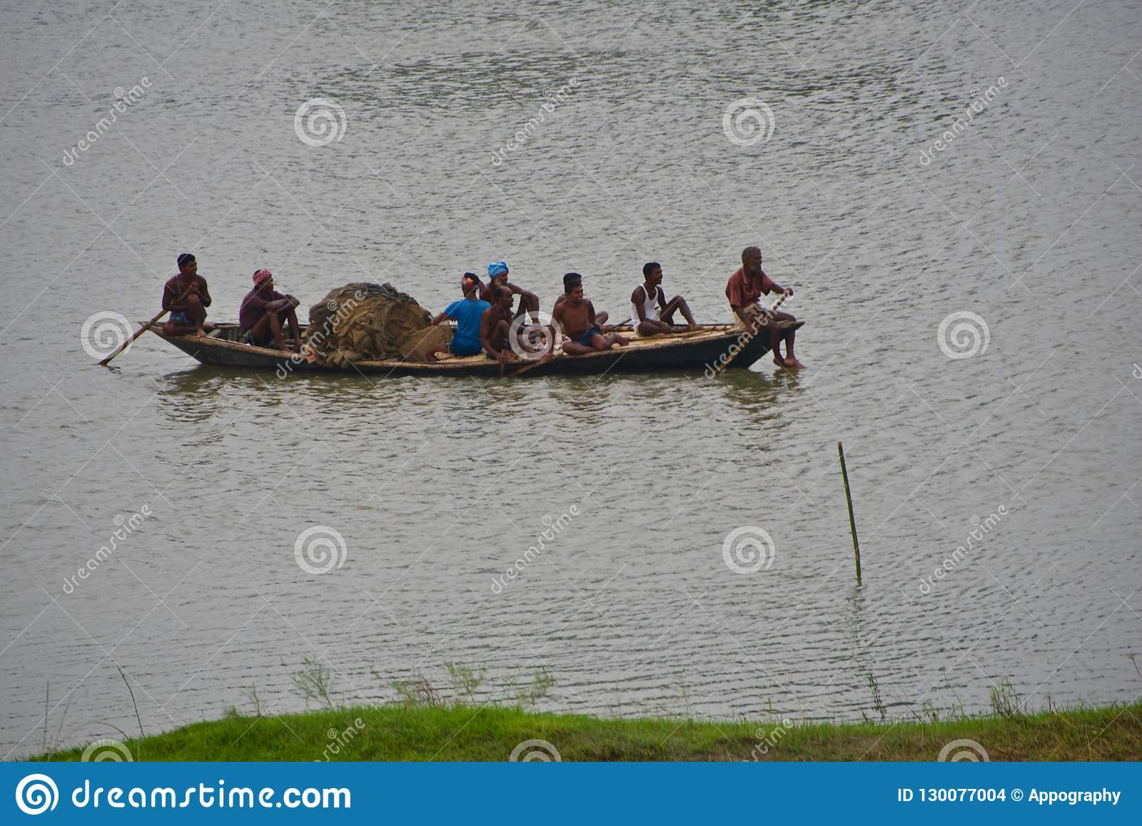 Fishermen travelling on a boat in the river