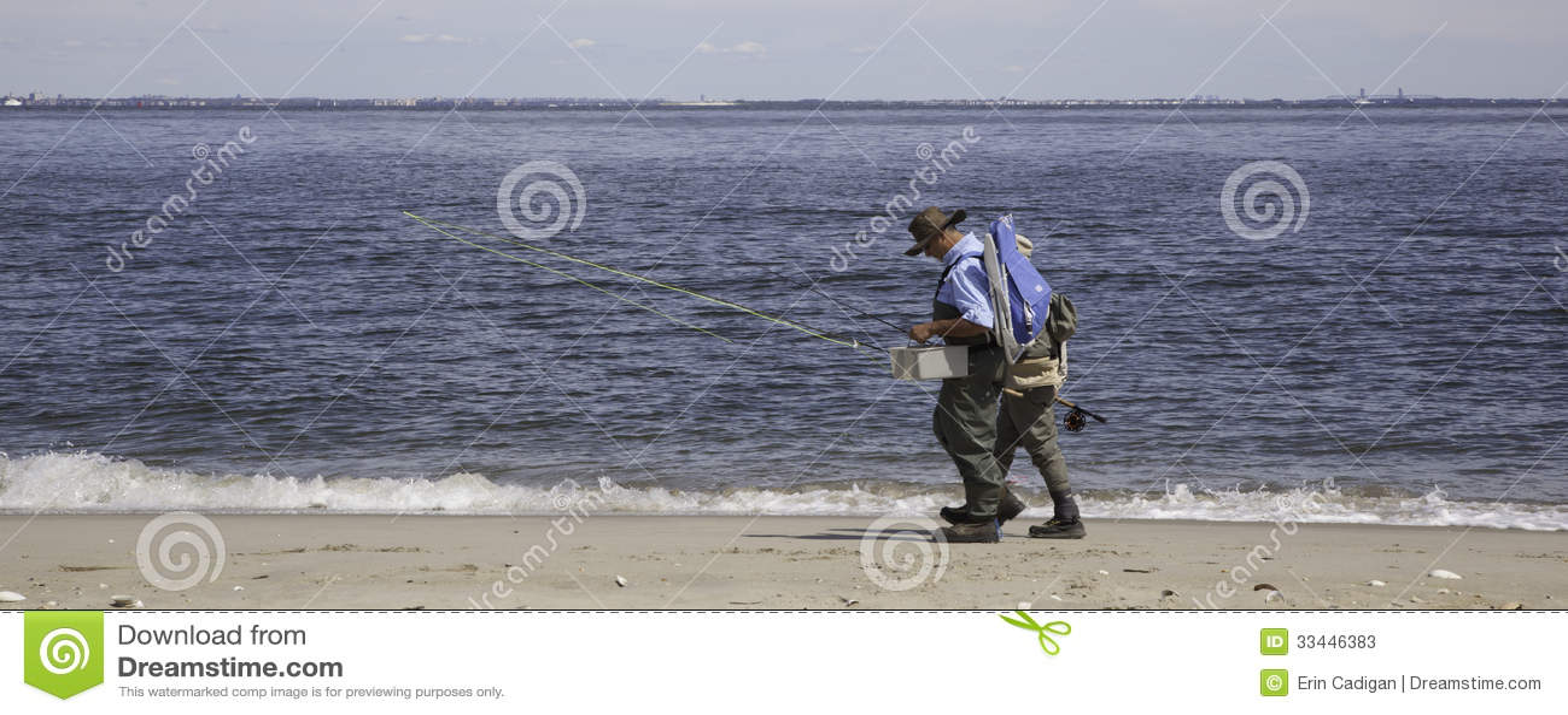 Fishermen walk along beach panorama editorial stock for Surf fishing nj license