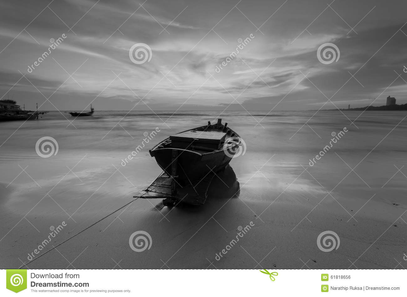 Download Fishing Boat At The Beach During Sunset In Black And White Stock Photo