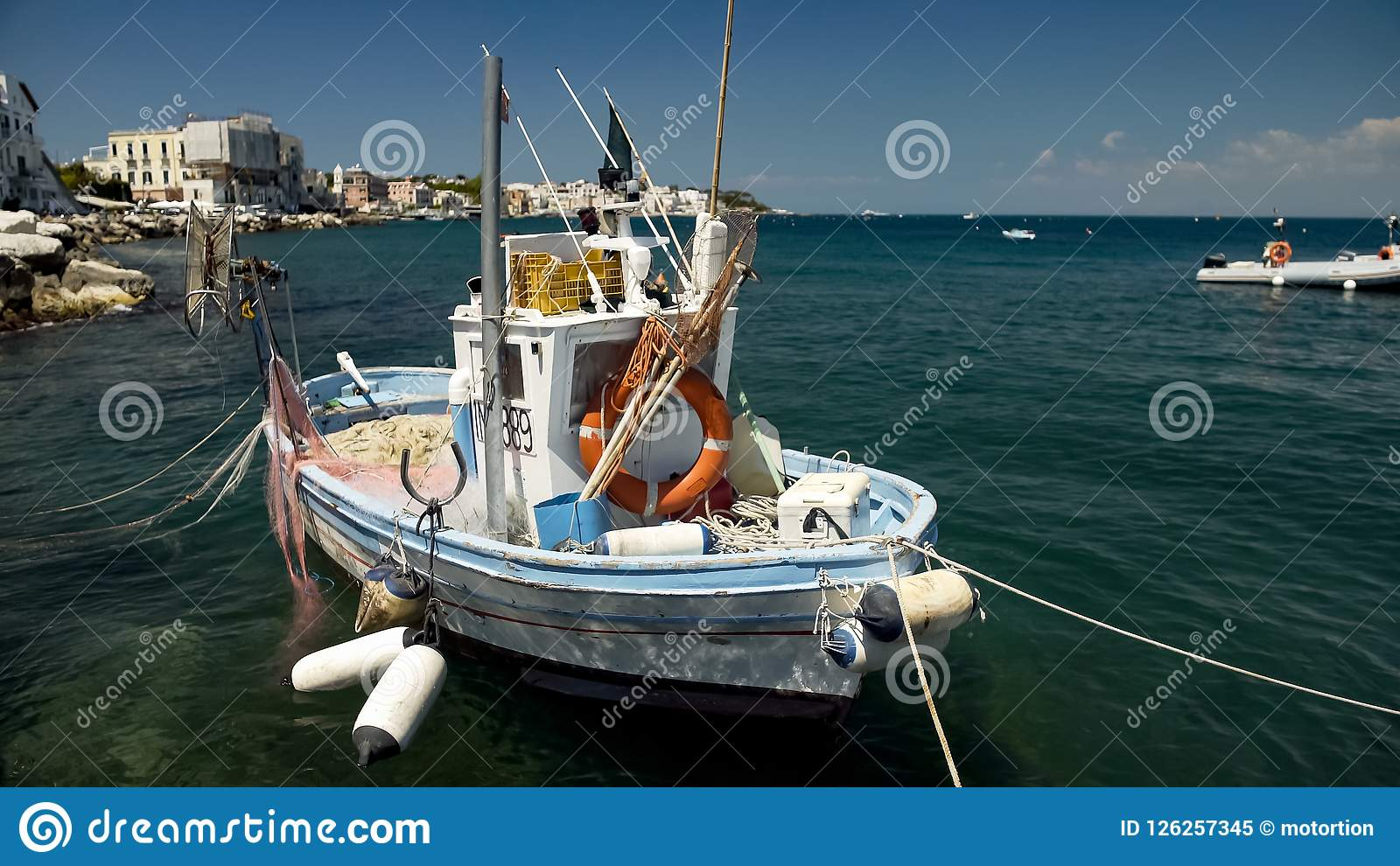Fishing Boat Floating On Water, Drift Nets Lying On Deck, Small