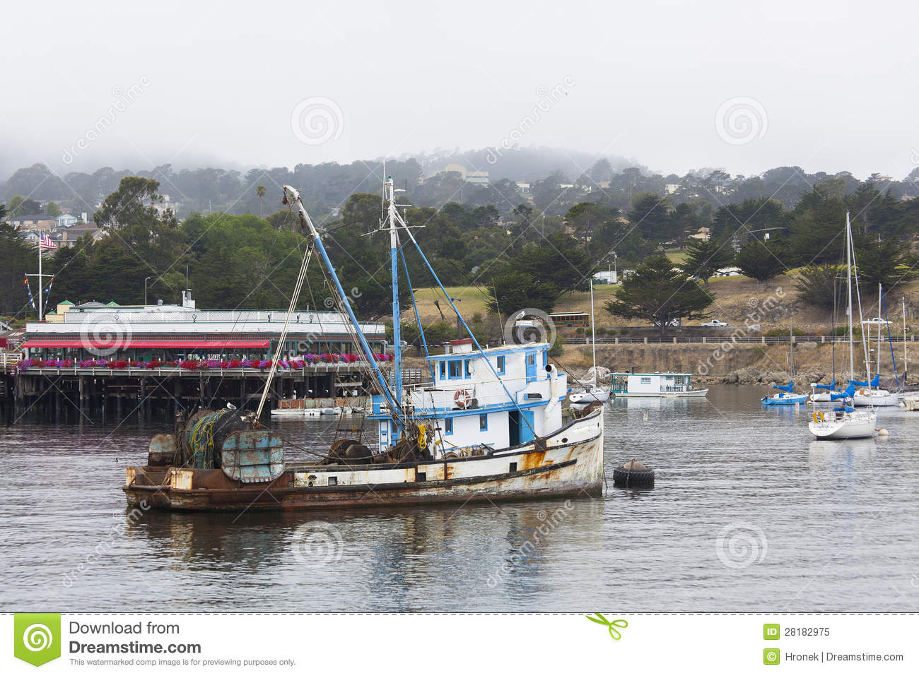 Fishing boat in a foggy monterey bay royalty free stock for Monterey sport fishing