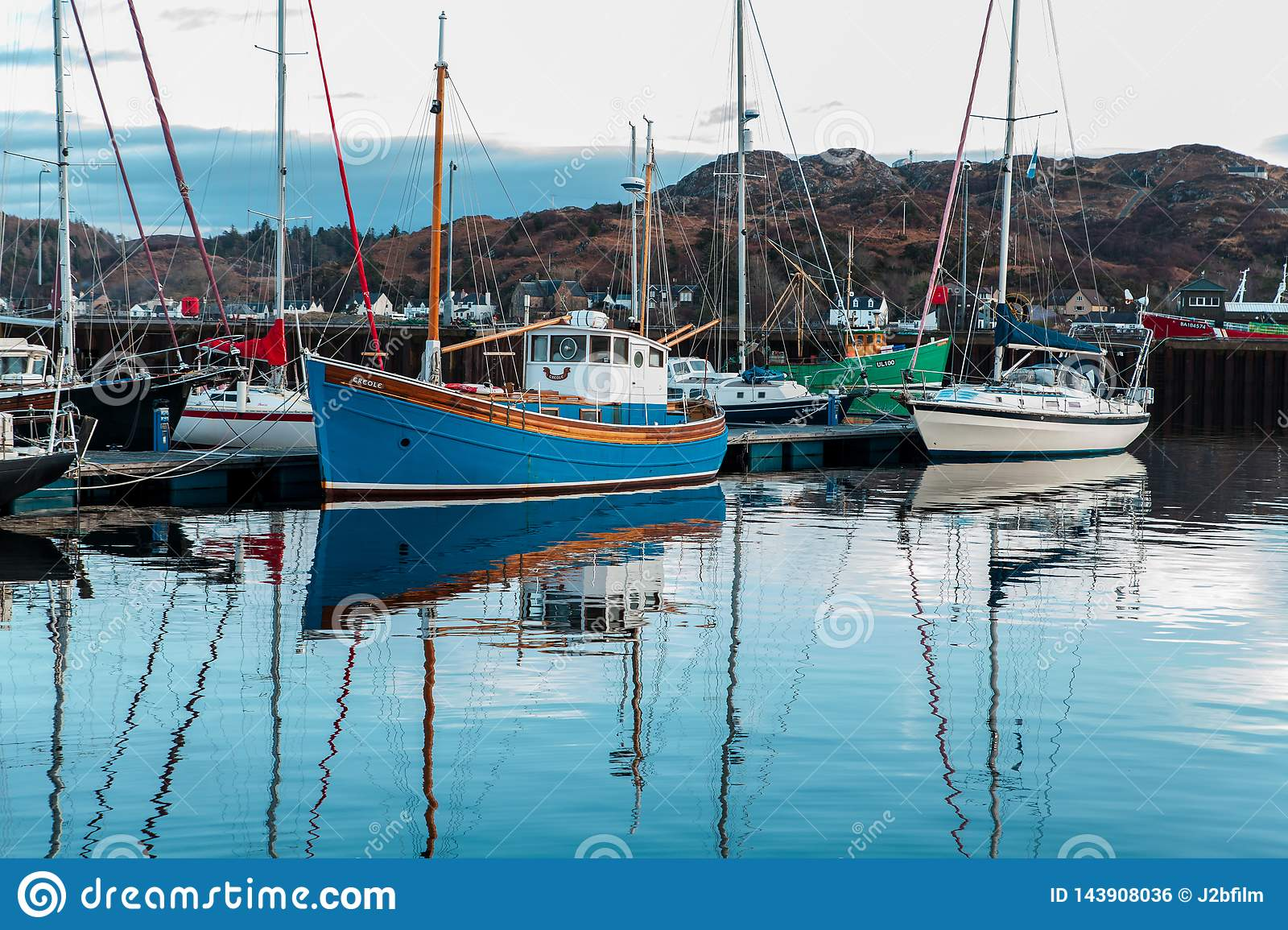The fishing boat moored in a jettie in Lochinver Marina