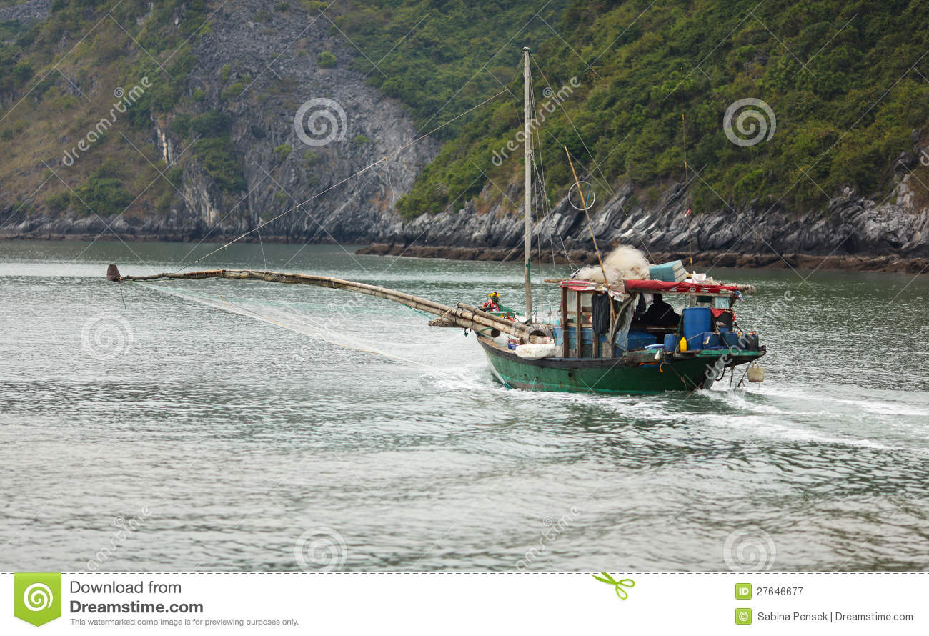 Fishing boat with net in Halong bay, Vietnam