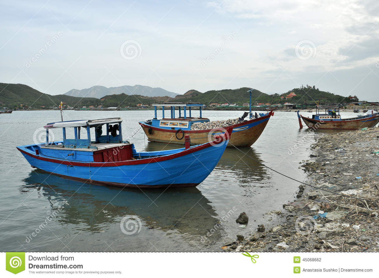 Traditional wooden fishing Boats on river, Vietnam