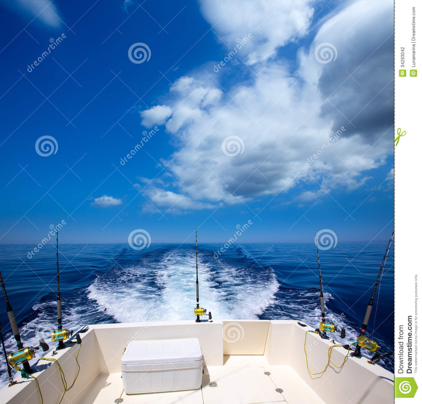Fishing boat stern deck with trolling fishing rods and for Ocean fishing rods