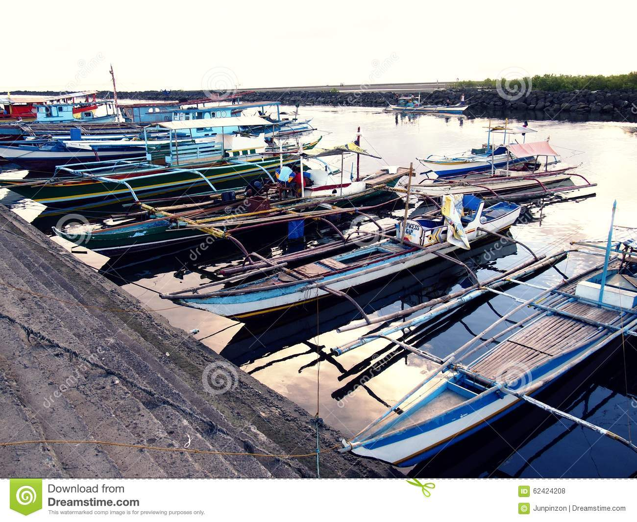 Fishing boats dock at at fish port or pier and replenish for Port a fishing