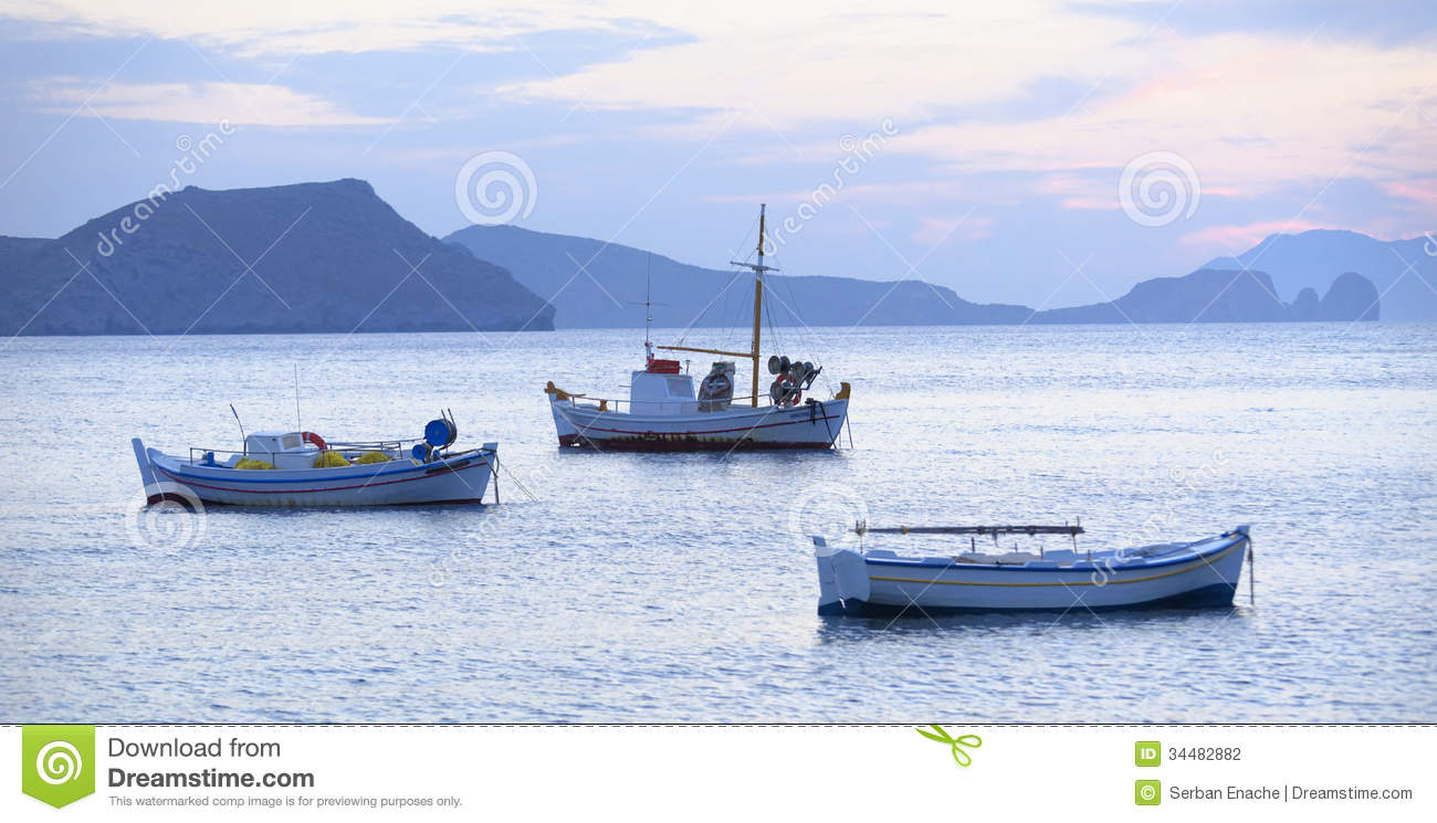 Download Fishing boats in Greece stock photo. Image of dawn, mountains - 34482882