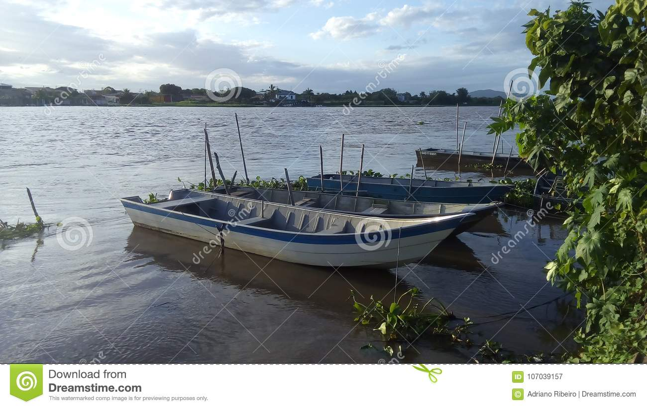 Fishing boats on the river bank