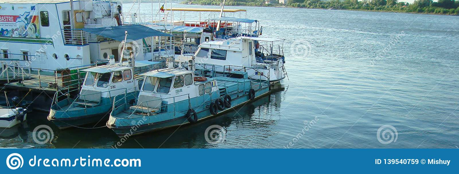 Fishing boats on Tulcea Harbour. Concept BANNER