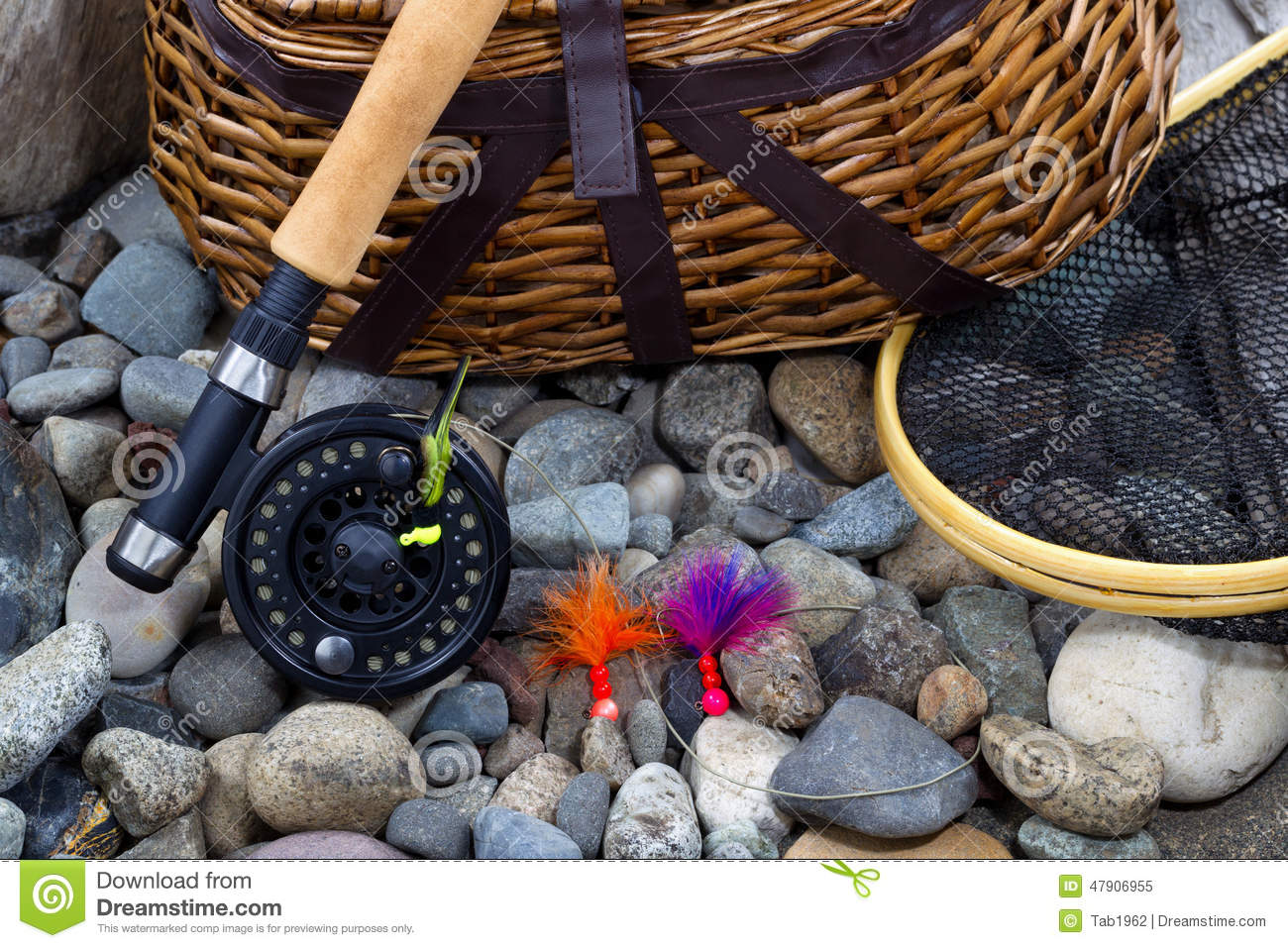 Fishing Equipment On River Bed Stones Stock Image - Image of river