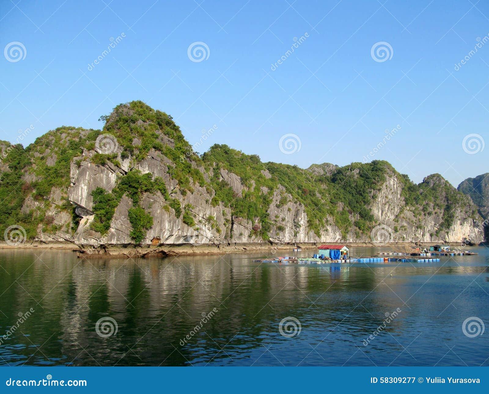 Fishing farm among limestone rocks in the sea