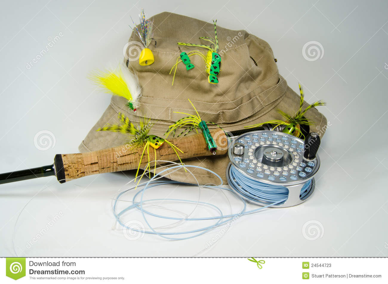 fishing hat with fly rod and reel with bass flies stock photos, Fly Fishing Bait