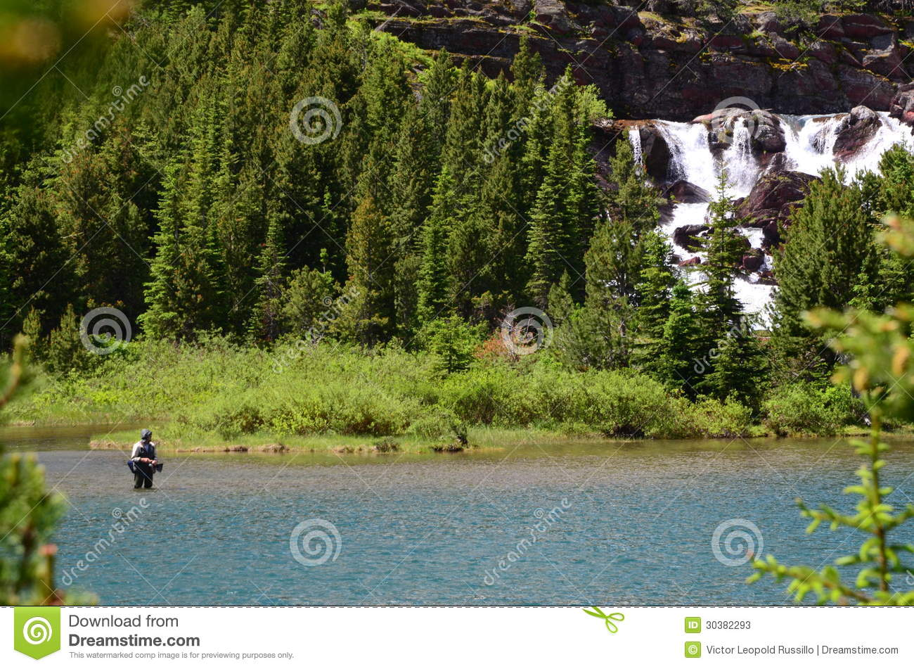 Fishing in montana lake stock photos image 30382293 for Fly fishing glacier national park