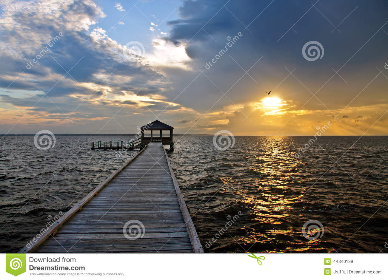 Fishing pier and dock at sunset stock photo image 44340139 for Outer banks sound fishing