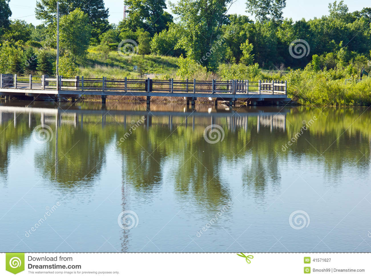 Fishing pier stock image image of millennium pier pond for Michigan fishing license prices