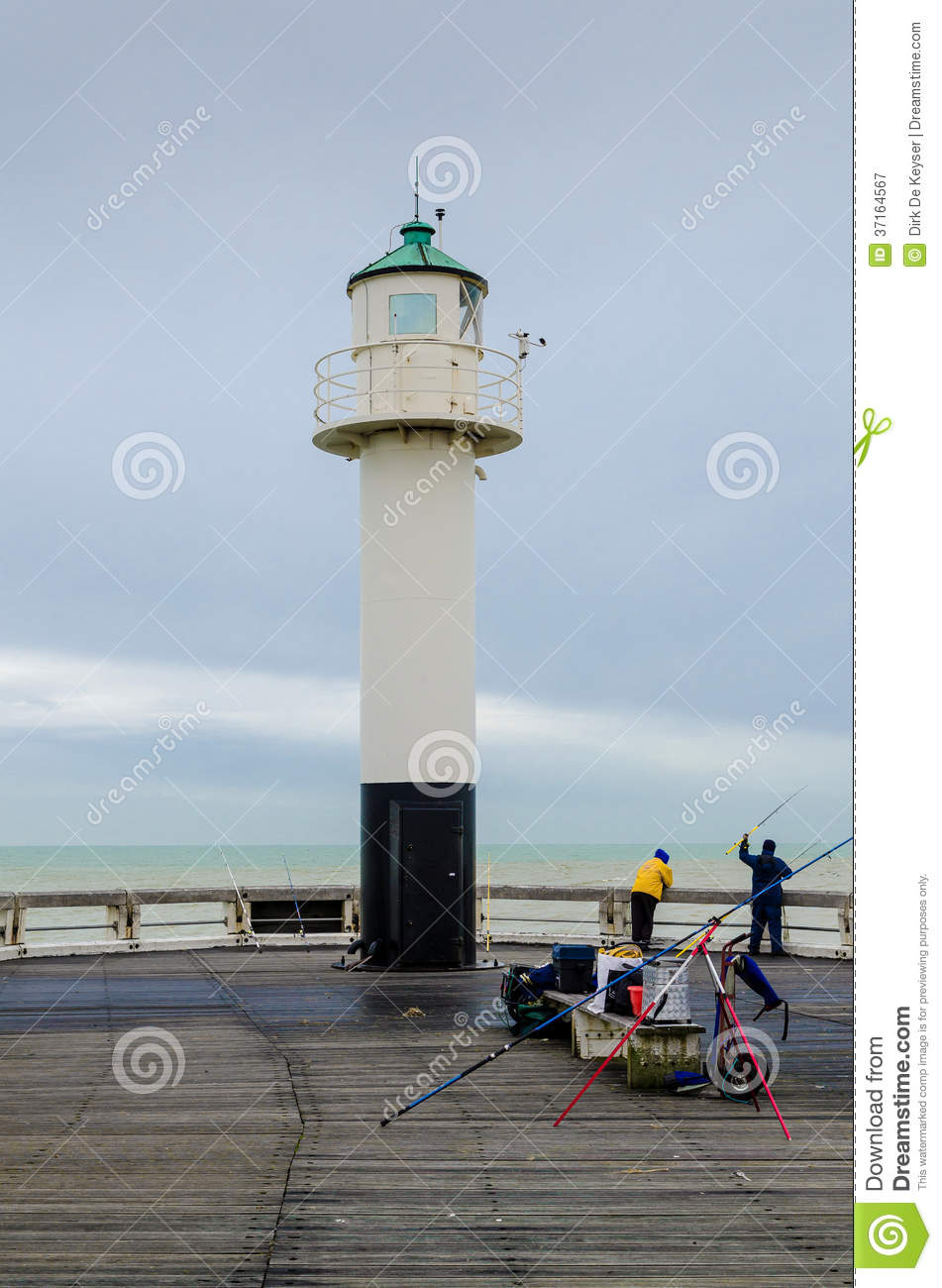 Fishing on the pier of Nieuwpoort, Belgium