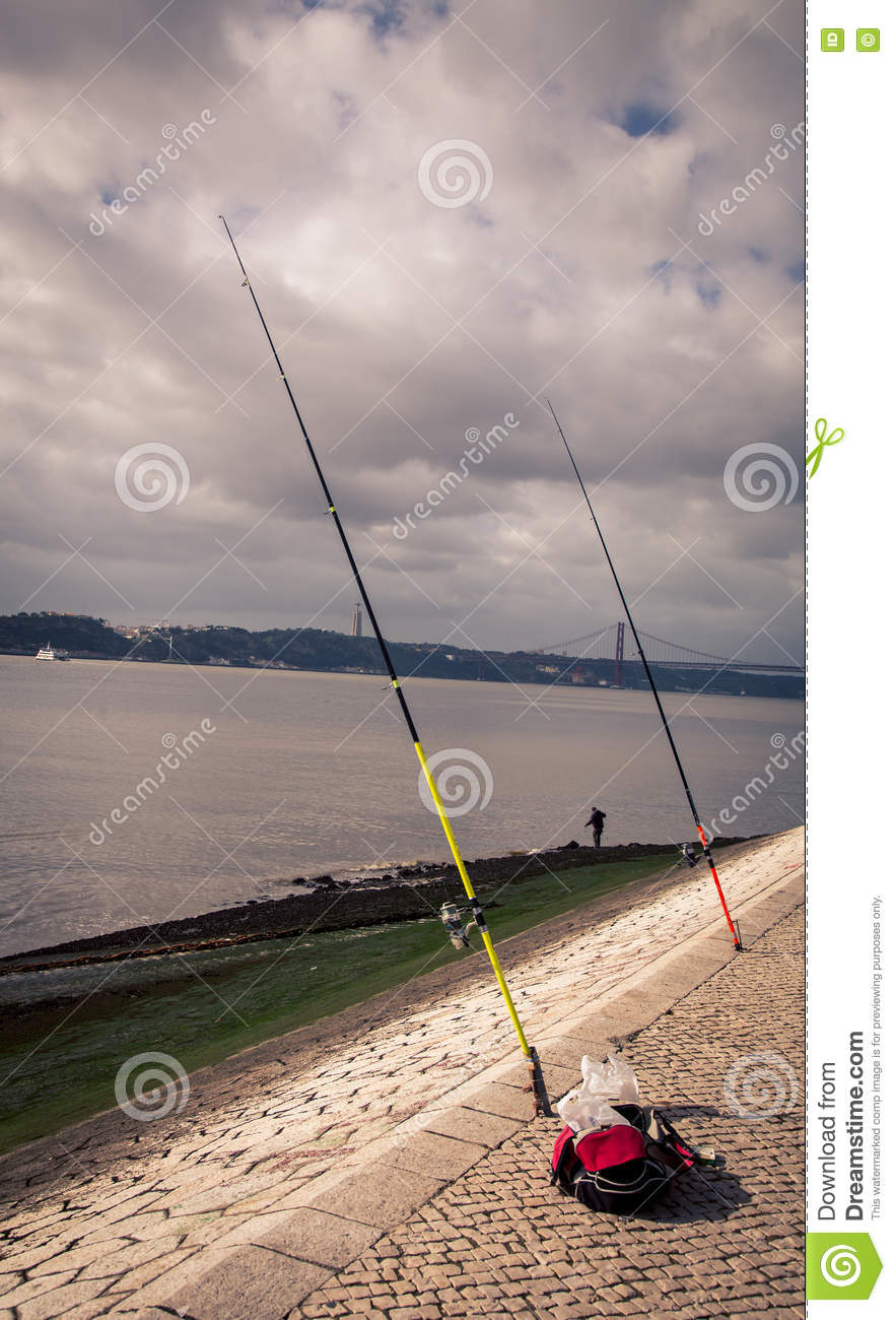 Fishing poles stuck in sand stock photo image 71972536 for River fishing pole
