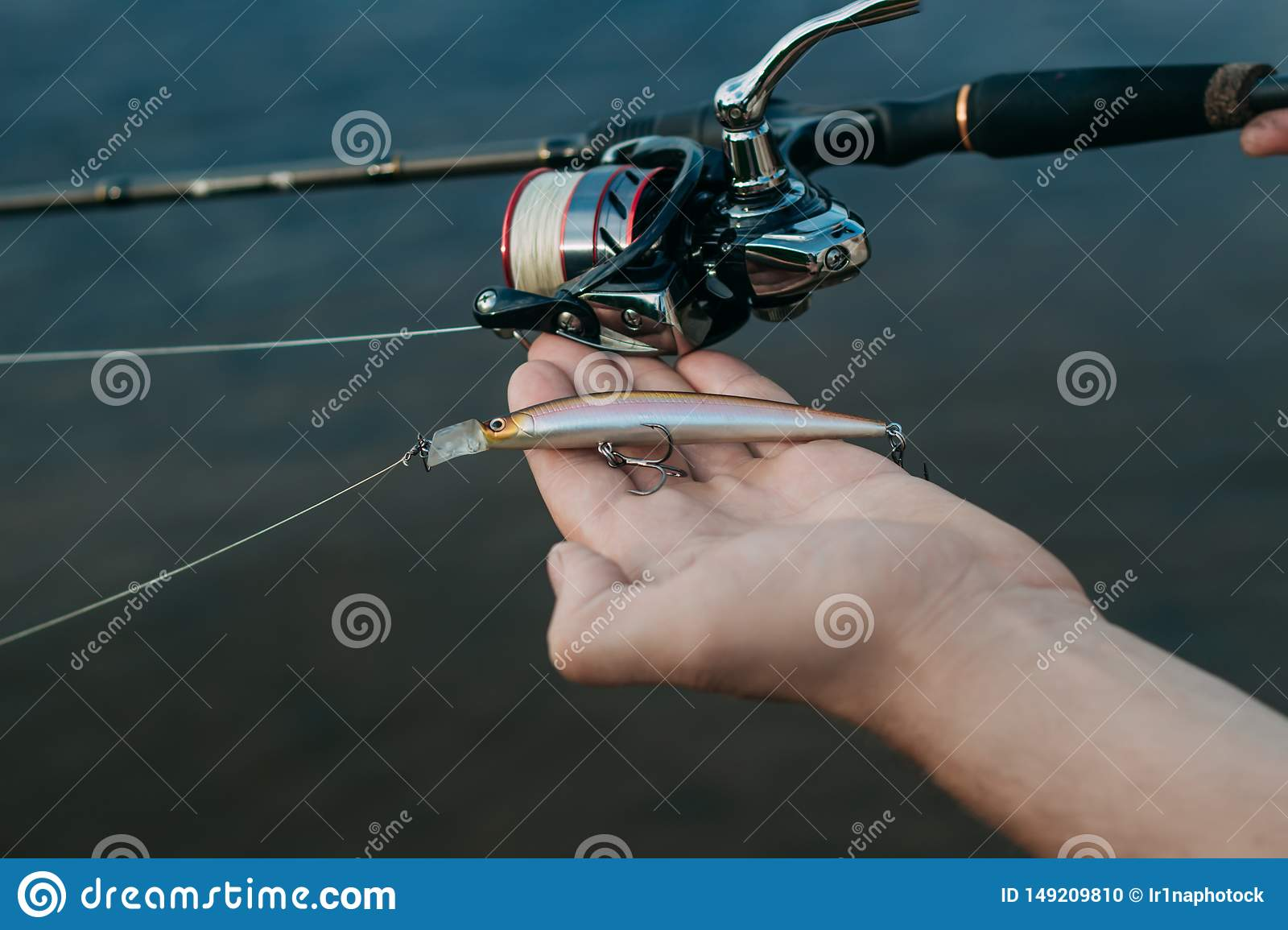 Fishing fish from shore with a stick, close up