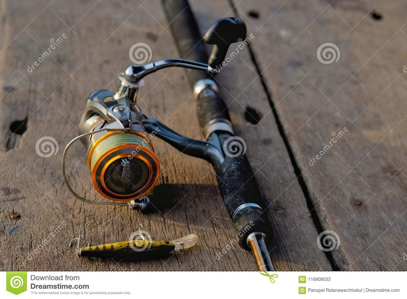 Fishing Rod And Fishing Bait On The Wooden Table Stock Image