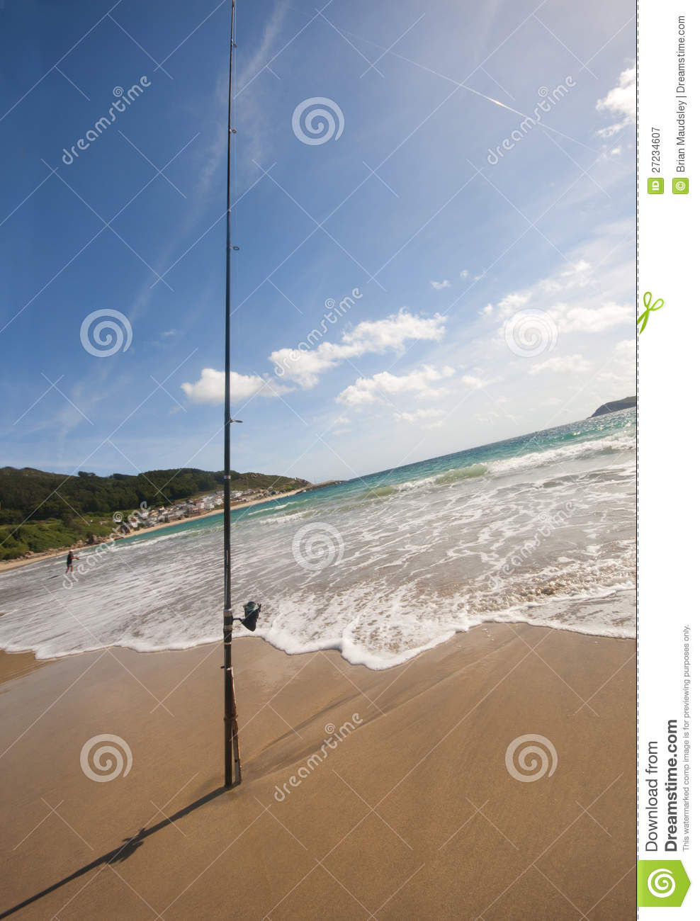 Fishing rod on a spanish beach royalty free stock for Fishing rod in spanish