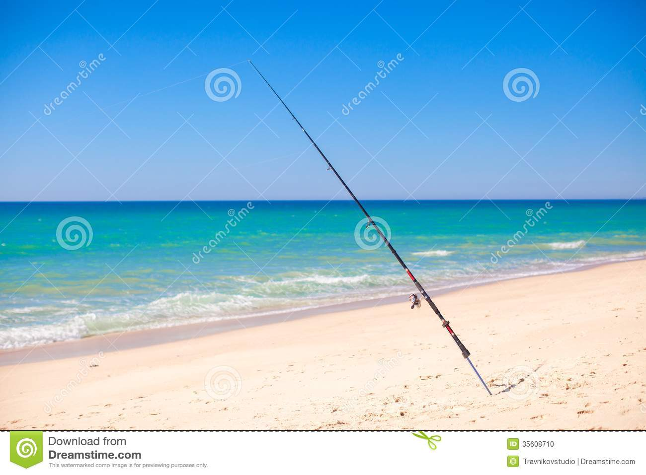 Fishing rod in white sand on tropical beach stock photo for Fishing rod in spanish
