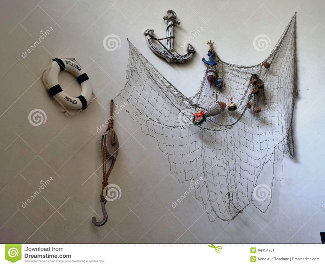 Fishing tool hanging on white wall stock photo image for Wall fishing tools