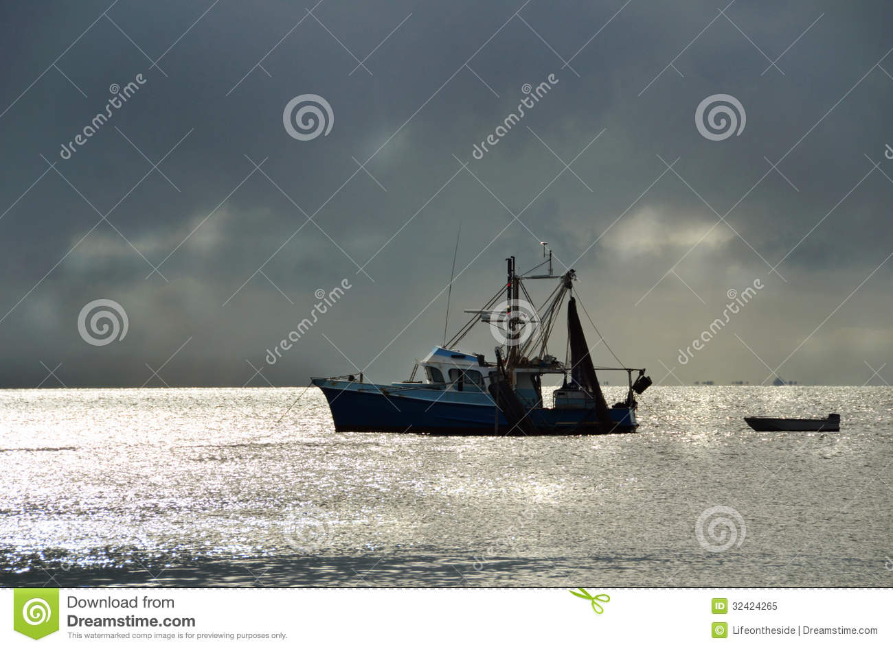 Fishing trawler boat in harbour stormy sunset royalty free for Fishing times free