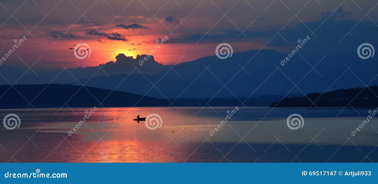 Beautiful Nature Orange Background.Colorful Artistic Wallpaper.Sunset,sunrise,clouds,blue sky.Panorama,water landscape.