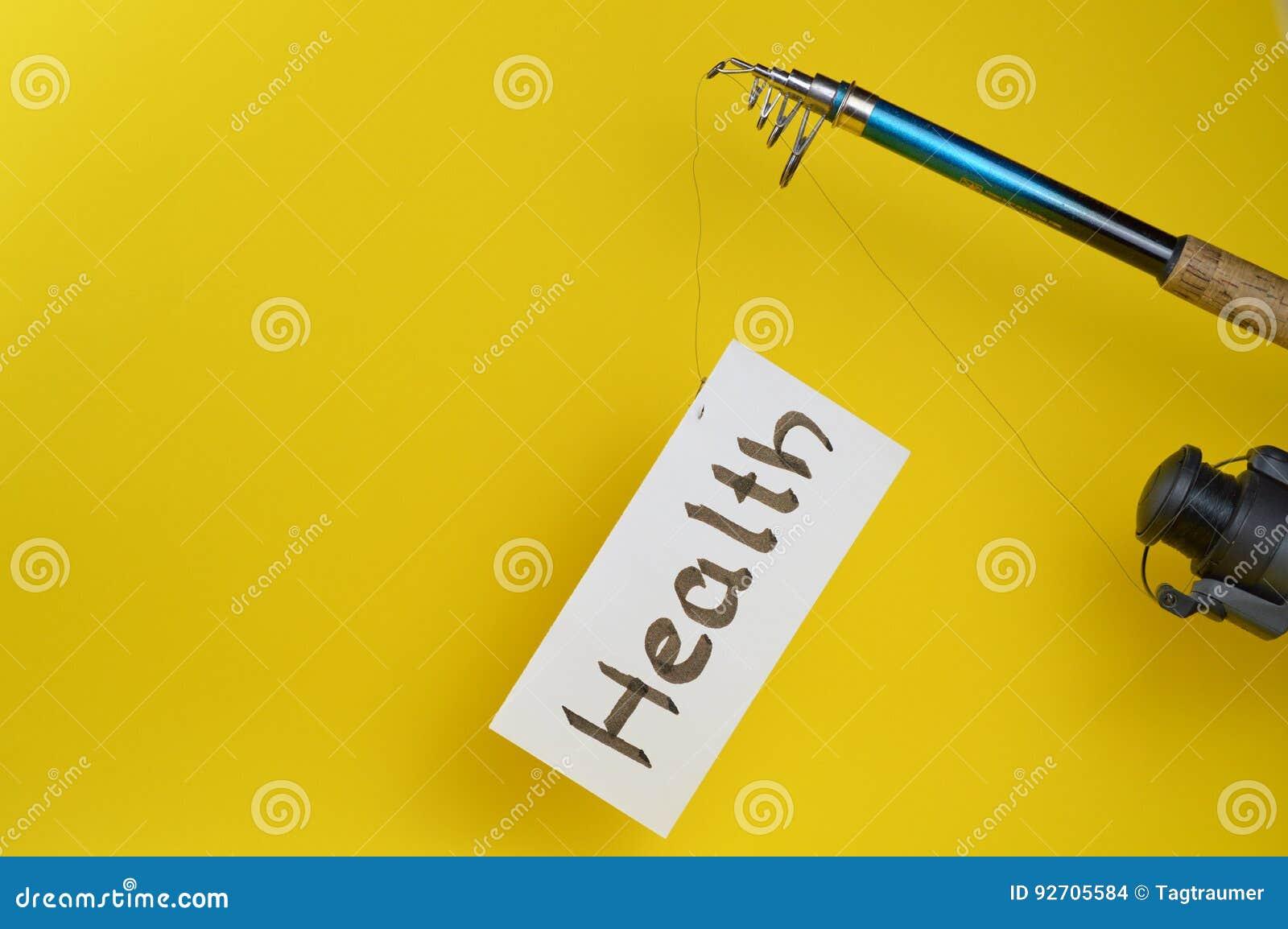 Fiskepol med papper och ordet HÄLSA