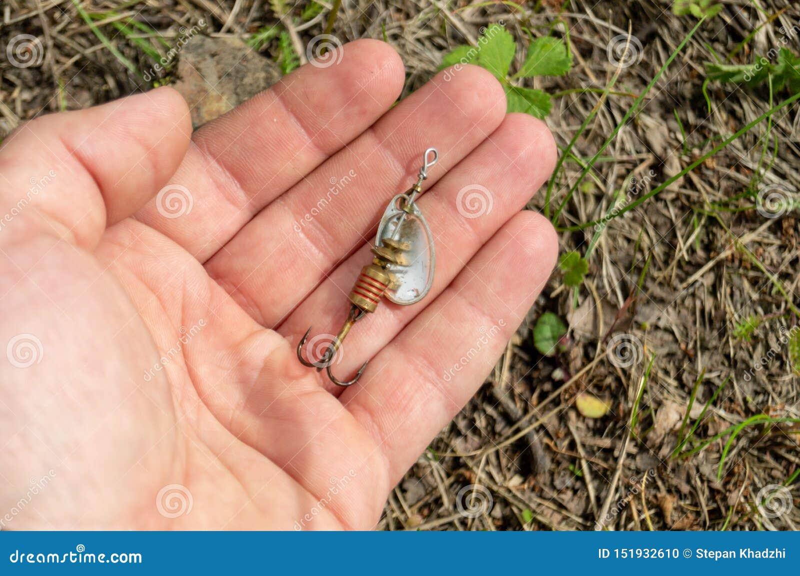 Fisketillbeh?r Struntsaker och lockar att ligga på en hand