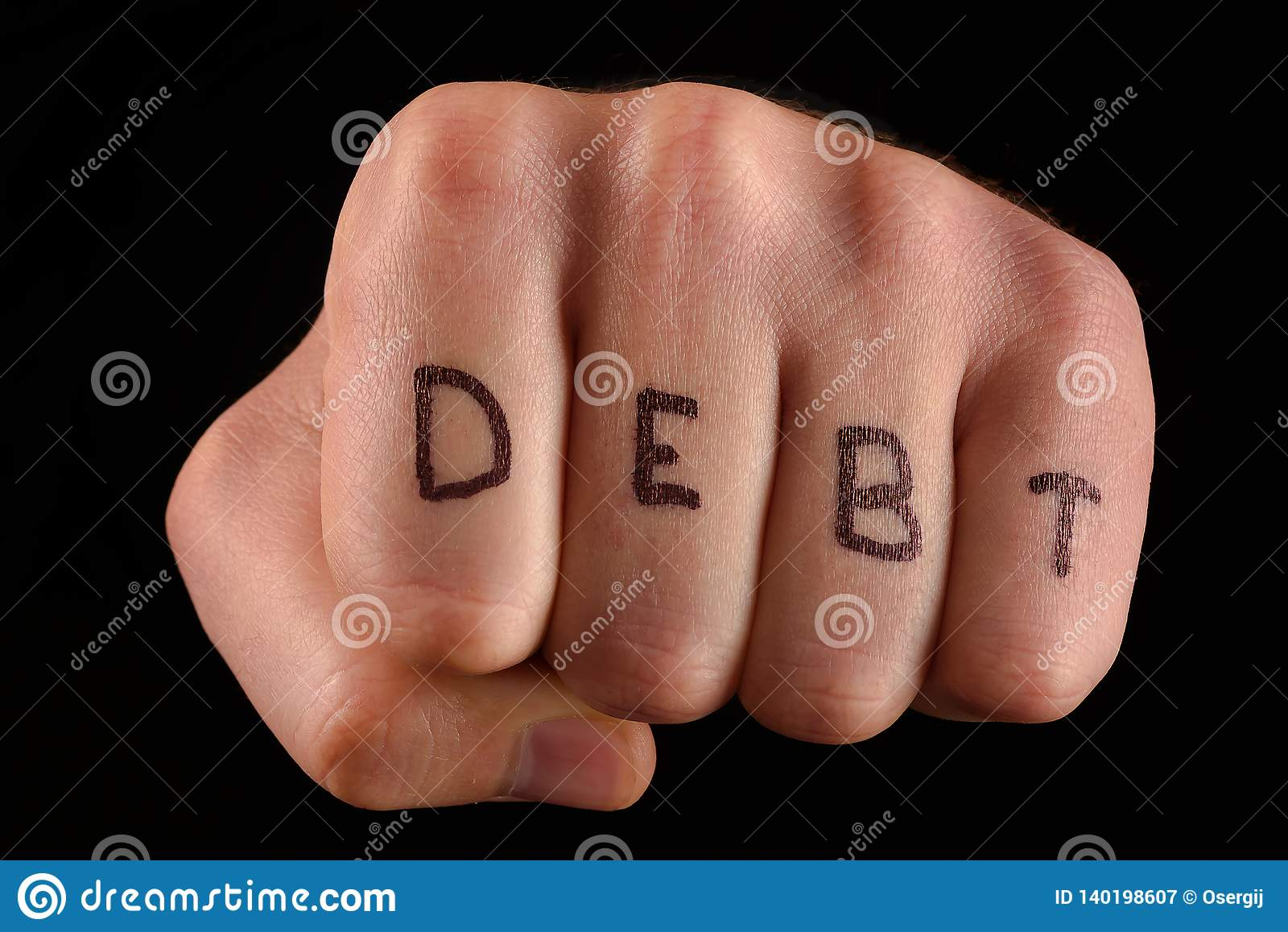 Fist on black background, inscription DEBT