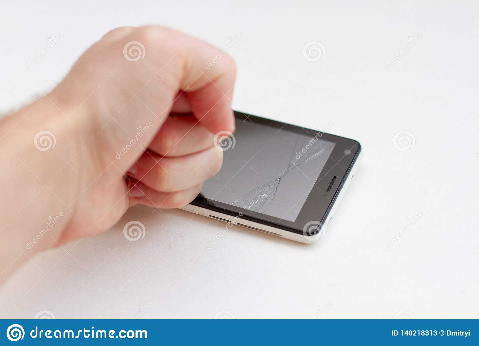 Hand breaks the smartphone on white background