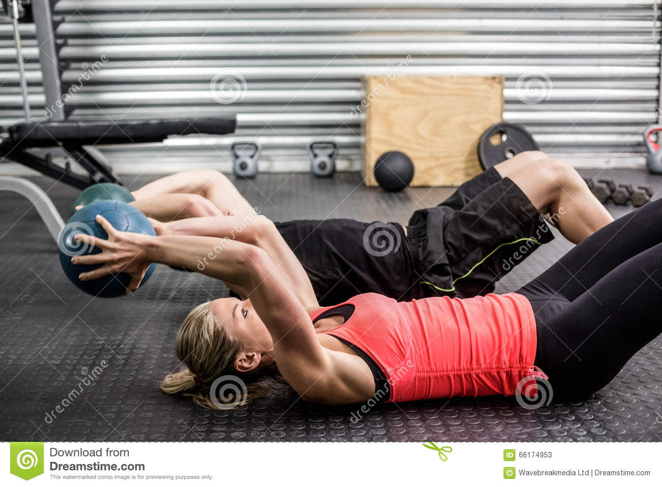 Fit couple doing abdominal ball exercise