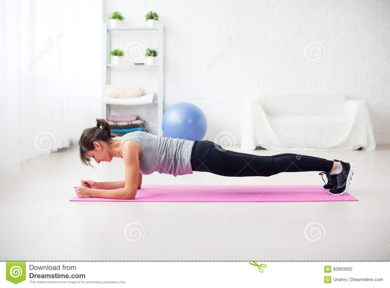 Fit Girl In Plank Position On Mat At Home The Living Room Exercise For Back Spine