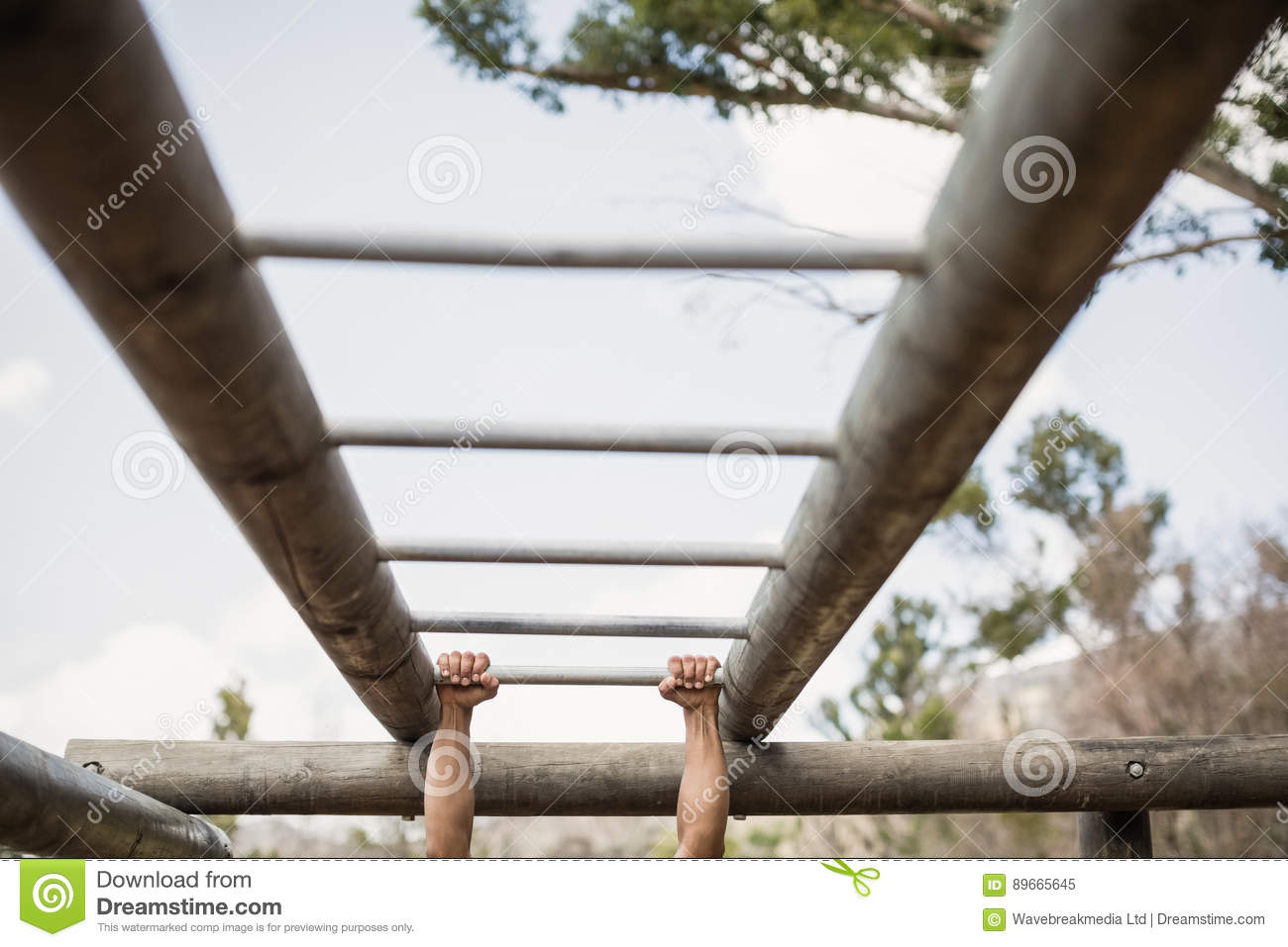 Download Fit Man Climbing Monkey Bars During Obstacle Course Stock Image - Image of camp, activity: 89665645