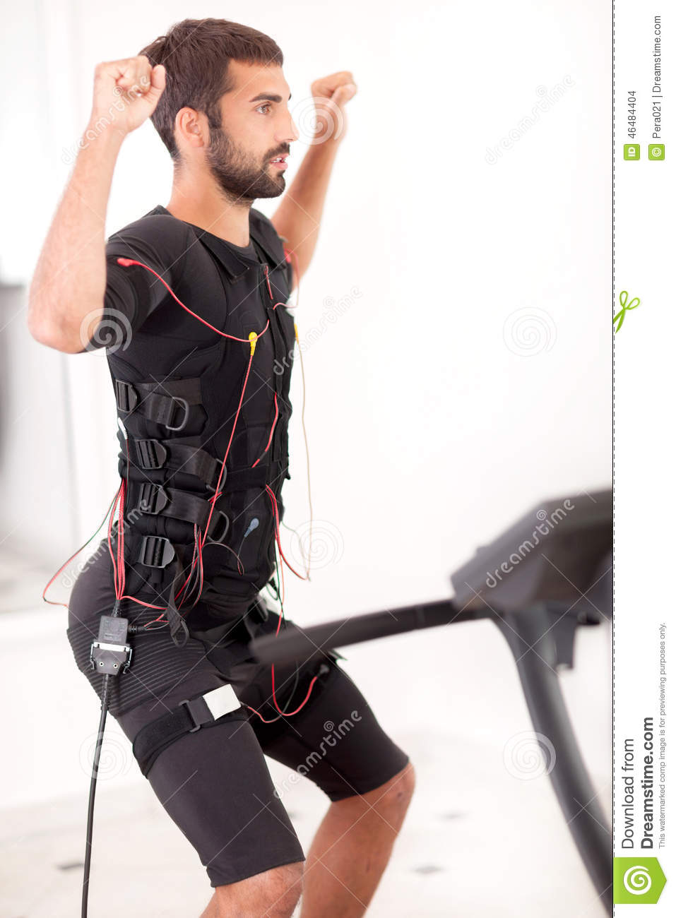 Fit Man Exercise On Electro Muscular Stimulation Machine ...