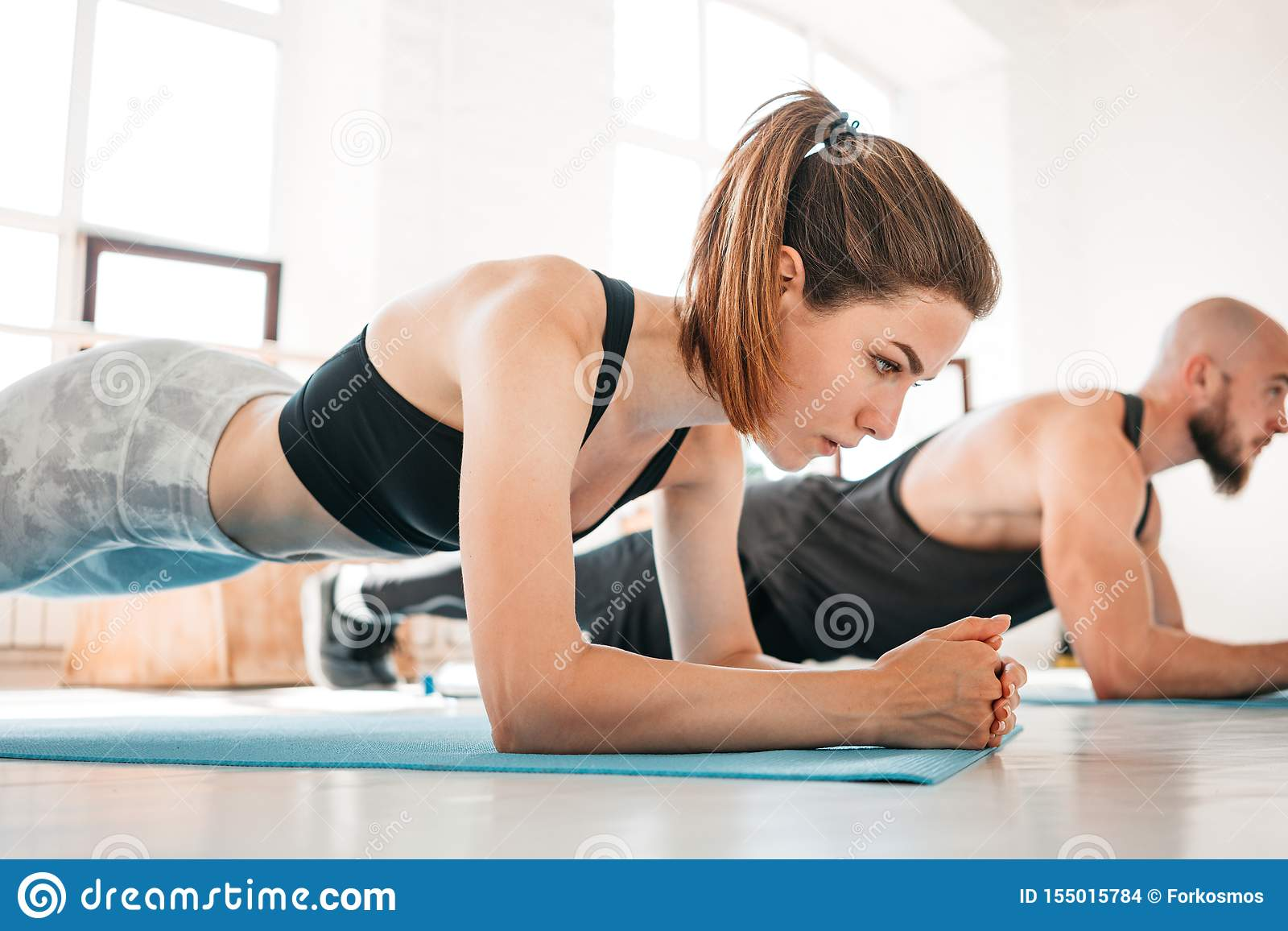 Fit Man And Woman Doing Abs Exercises Together Stock Photo Image Of Coach Health 155015784 Side view of disabled sportswoman with prosthesis doing sit ups woman in swimsuit with perfect abs, fit body. https www dreamstime com fit man woman doing abs exercises together people working out gym fit men women doing abs exercises together image155015784