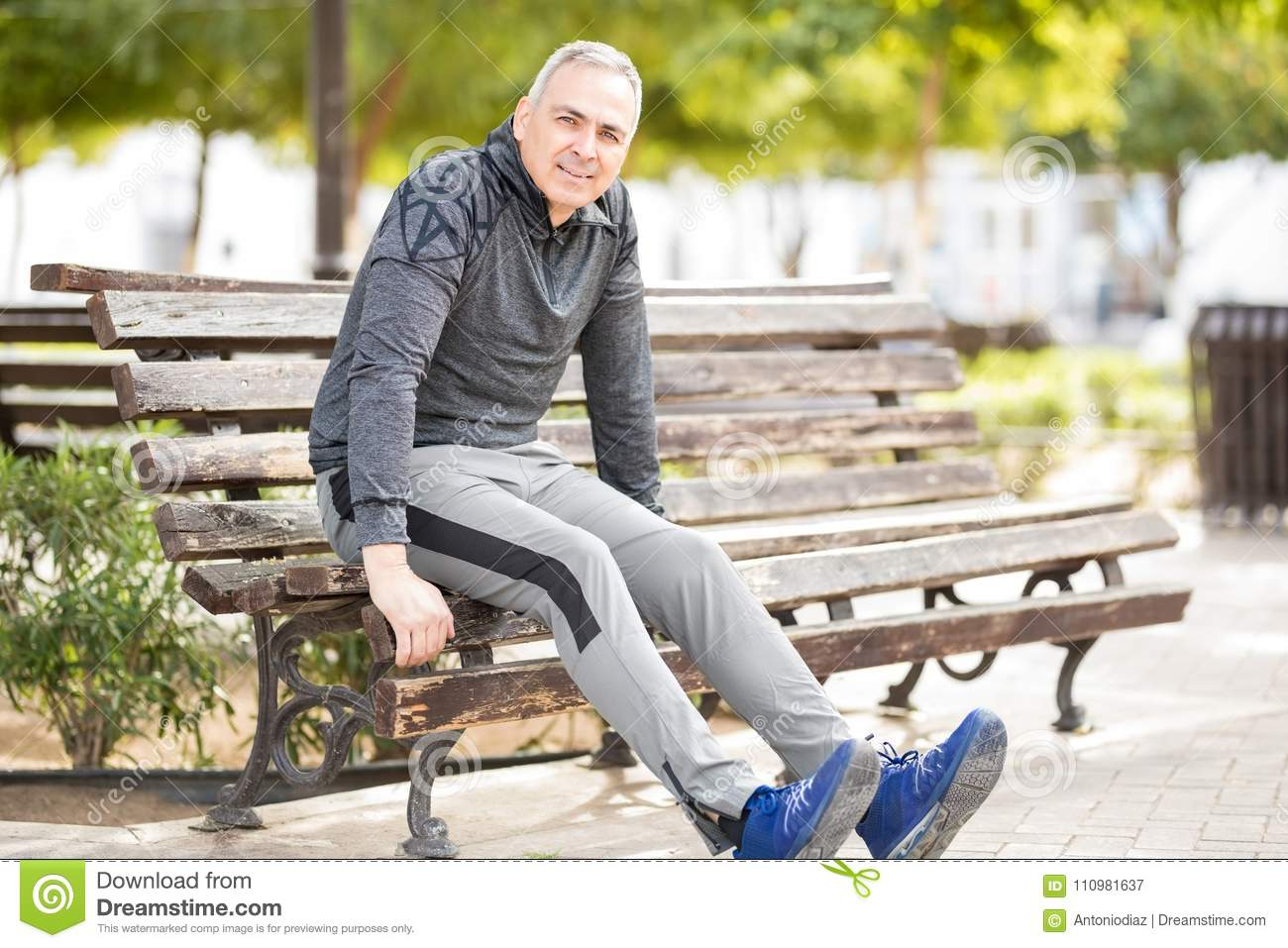 Mature on a park bench