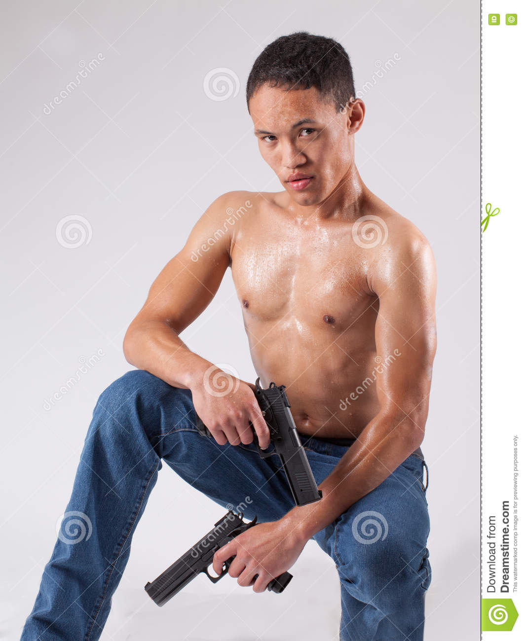Studio Shot Of Young Muscular Persian Man Thinking While