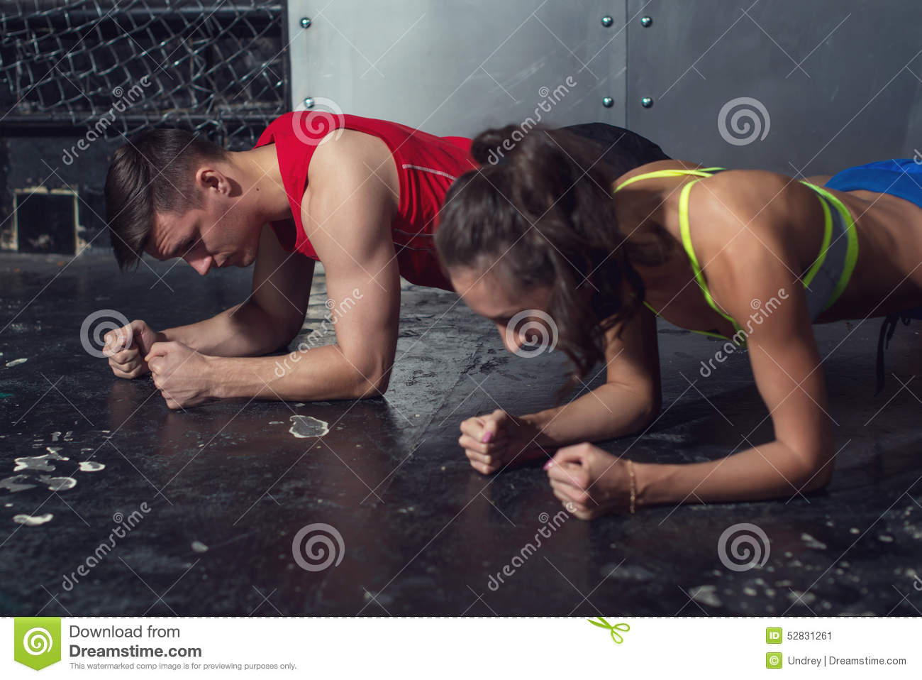 Fit sportive man and woman doing plank core
