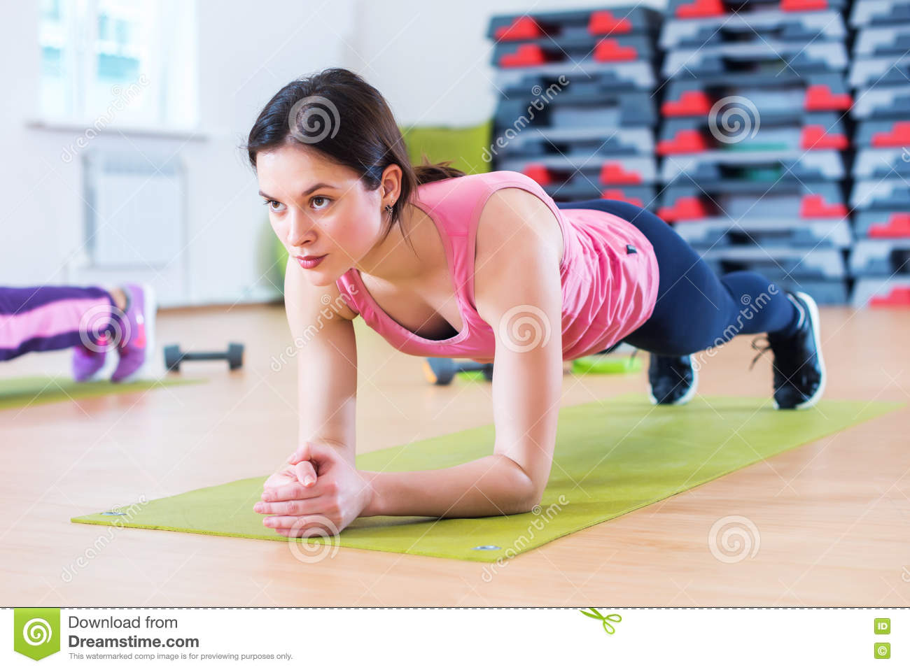Fit sportive woman doing plank core exercise training back and press muscles concept gym sport sportsman fitness workout