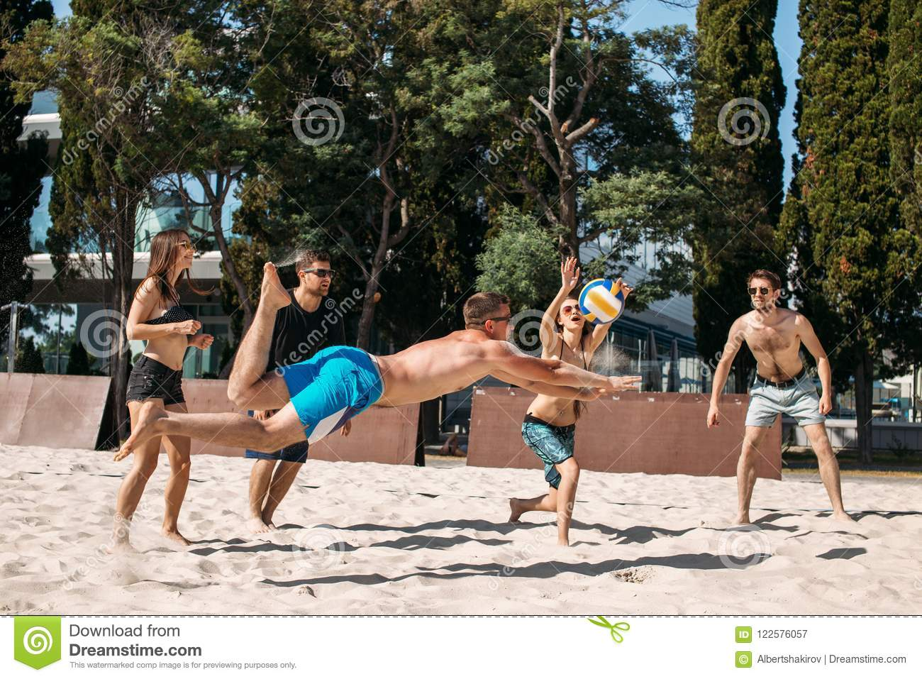 Beach Volleyball Players In Motion, Jumping And Stock Image ...