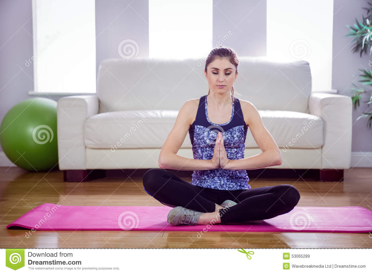 Fit woman doing yoga on mat stock photo image 53065289 for Living room yoga