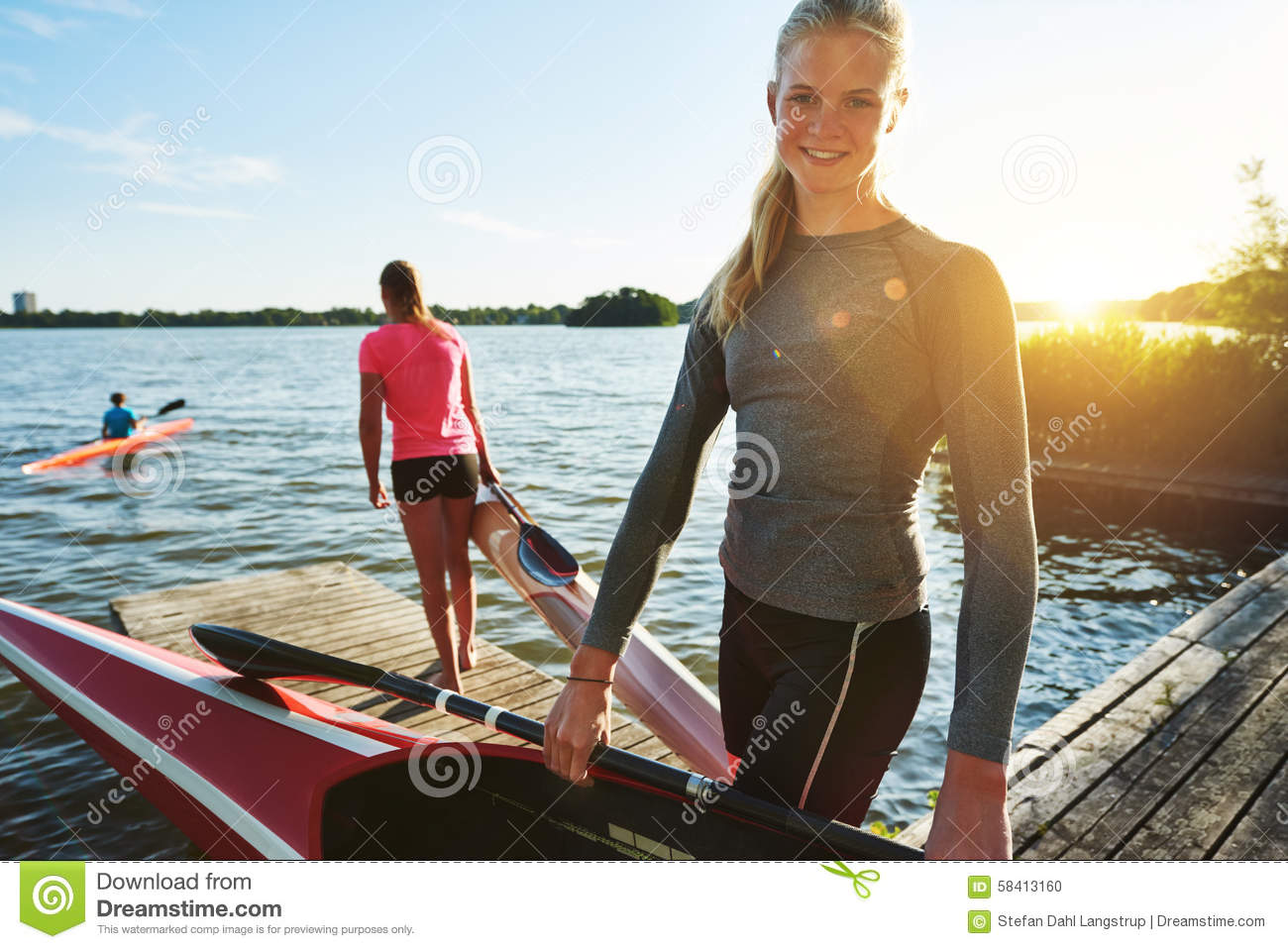 Fit woman with a kayak