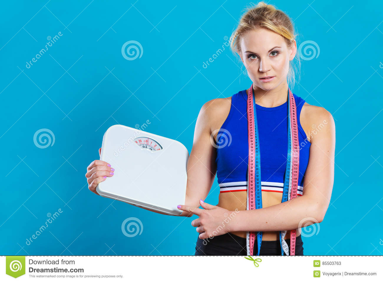 Background image scale to fit - Fit Woman With Measure Tape With Weight Scale Stock Photo