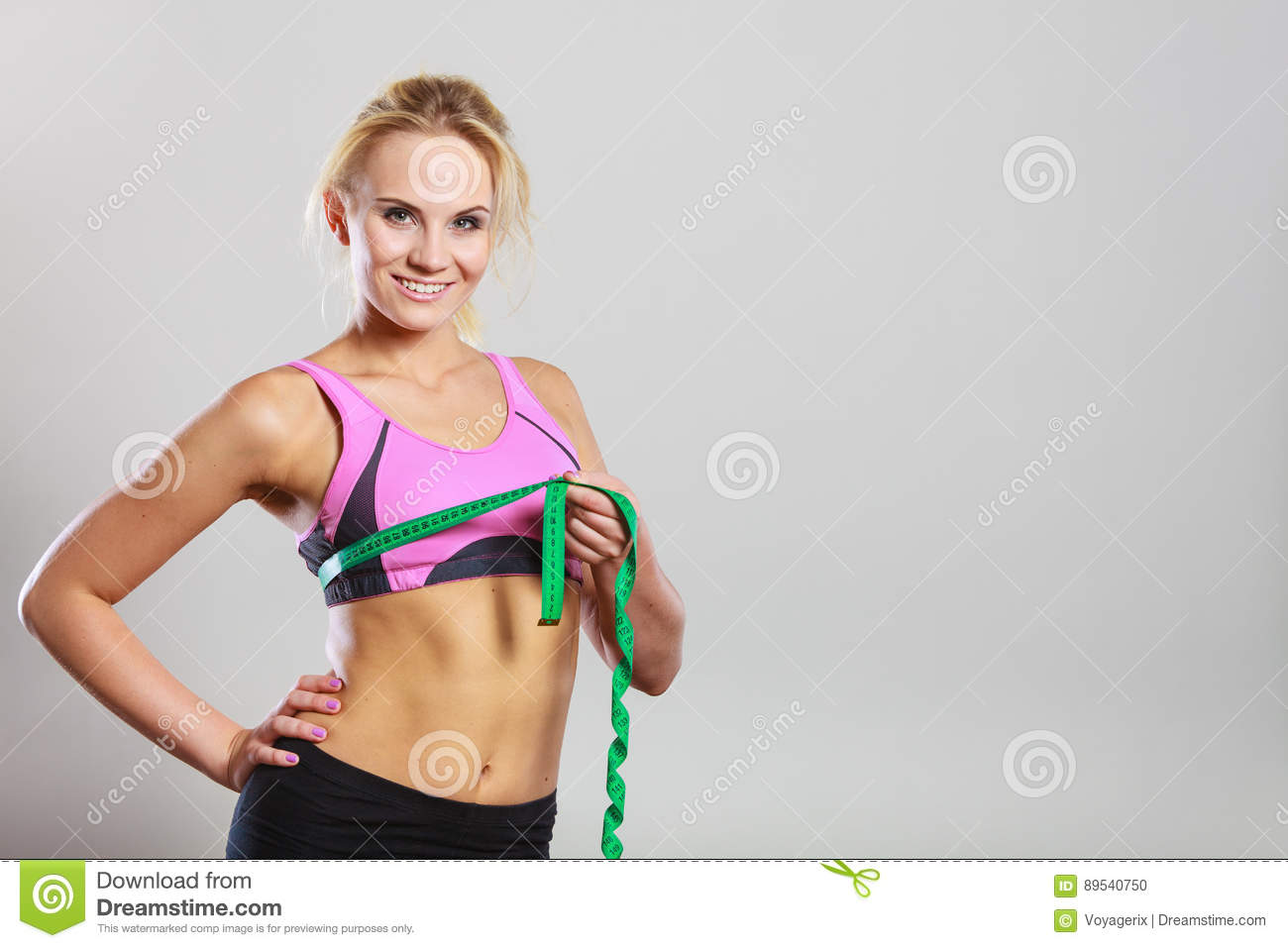 Fit Woman Measuring Her Chest Breasts With Tape Measure